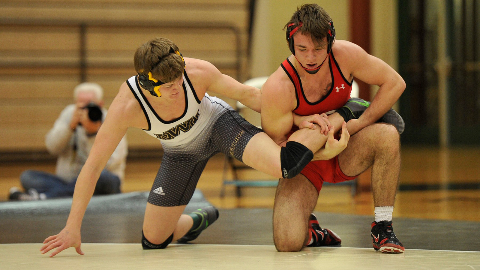 Central takes both ends of wrestling triangular